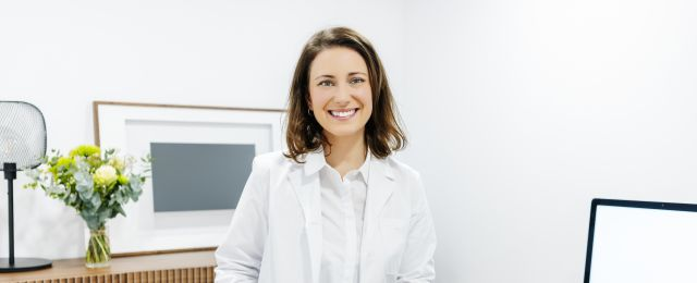 Portrait of smiling doctor in her medical practice